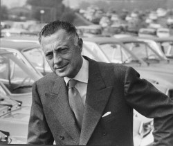 Gianni Agnelli posing in front of Fiat cars. 1970.