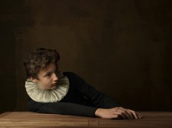 Boy with white collar at table